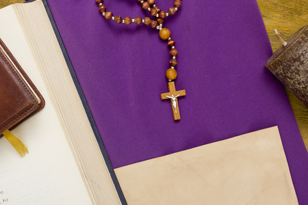 canonical: Canonical crucifix catholic church cross on the purple fabric.
