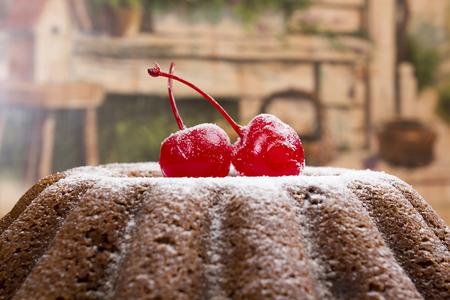 christmas pudding: English Christmas pudding with cherry. Traditional birthday cake. Stock Photo