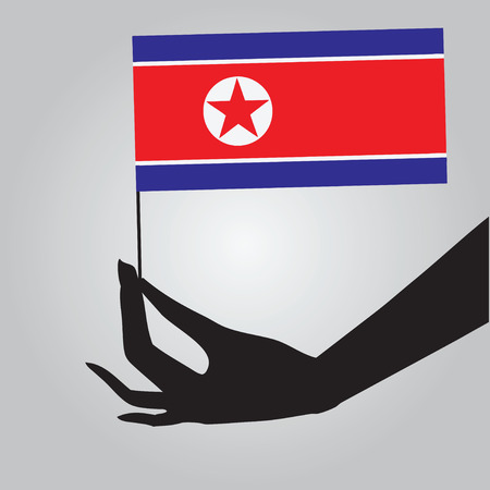 north korea: Flag of North Korea in a female hand.