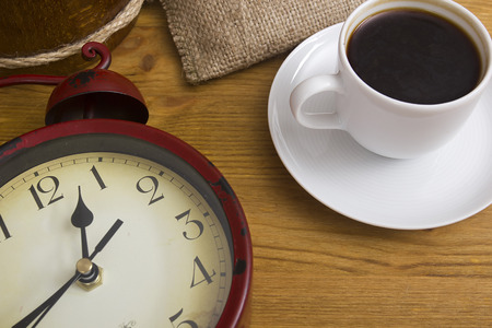 second breakfast: A break with a cup of coffee. The symbolic clock and a cup of coffee. Stock Photo