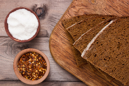 brown bread: Variety of brown bread on the chopping board, and salt.