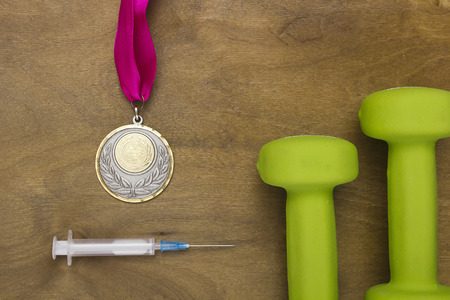 obtained: Medal obtained through use of doping. Doping for an athlete.