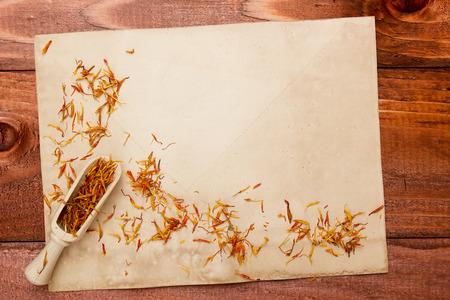 dried flower arrangement: Saffron petals on an old piece of paper.