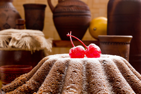 old english: English Christmas pudding with cherry and old accessories. Stock Photo