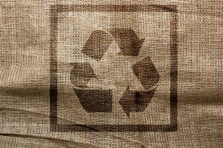 sackcloth: Stamp on sackcloth, industrial recycling symbol. Logistical symbols.