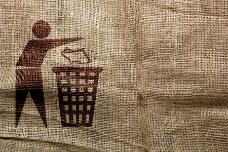 ecologically: Stamp on sackcloth, throw away the trash. Industrial symbolism. Stock Photo