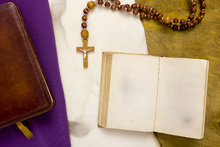 Ancient book with a religious Catholic cross.
