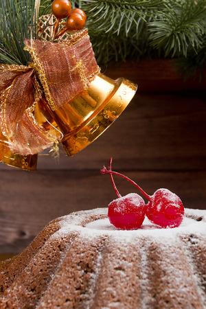 fruitcake: Classic New Year fruitcake decorated with cherries. Stock Photo