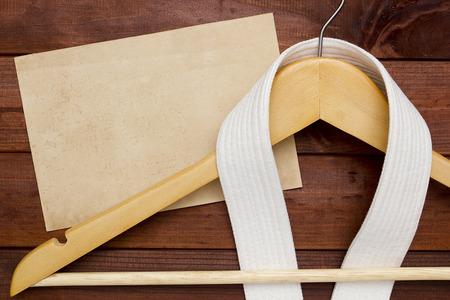 bushido: White Belt Karate on a clothes hanger. Stock Photo