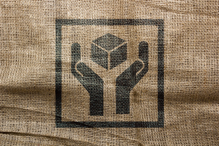 careful: The industrial character of the stamp on the bag, careful attitude to send goods. Stock Photo