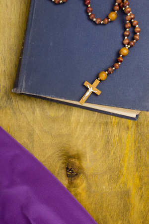 hymn: A small wooden catholic cross on a wooden chain. Stock Photo