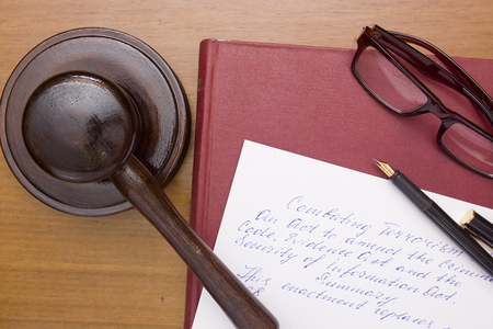Legal practice related to terrorism, drafting of legal documents. Reklamní fotografie - 52215840