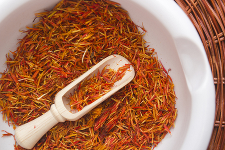 dried flower arrangement: Inflorescence of saffron in a ceramic mortar and expensive spice saffron.