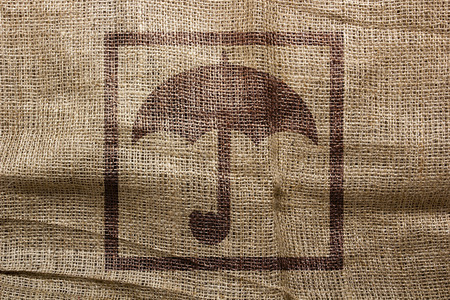 consignment: Industrial symbol on bag, a stamp in the form of an umbrella. Logistical symbolism of the consignment from moisture. Stock Photo