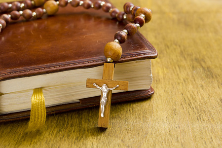 brethren: Catholic wooden cross with a crucifix on the book