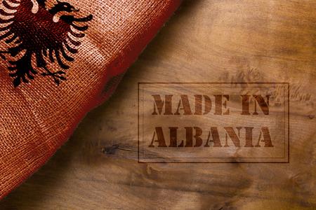 sackcloth: Made in Albania. The national flag of Albania stylized sackcloth.