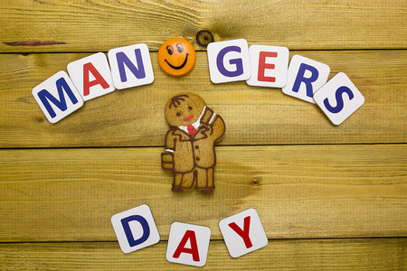 International Day of manager creative greetings with a dough biscuit. Stock Photo