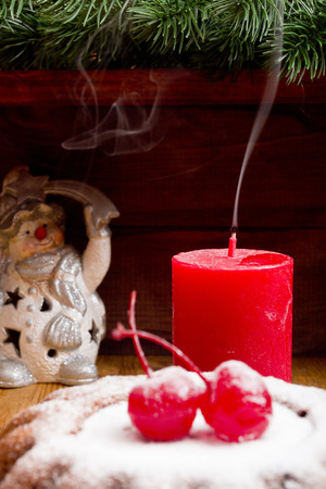 dark night: Christmas candle extinguished with the remnants of smoke and the New Year accessories.