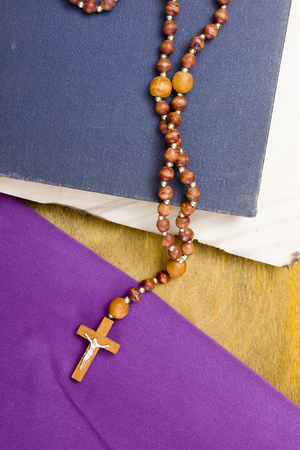 ascetic: A small wooden catholic cross on a wooden chain. Stock Photo