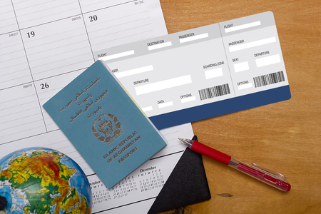 The passport of the citizen of the Republic of Afghanistan, and the form of a plane ticket. Stock Photo