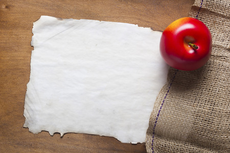 sackcloth: Sackcloth and paper on wooden background Stock Photo