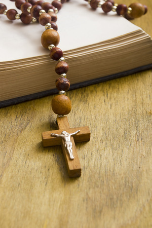 piety: Catholic wooden cross with a crucifix on the book