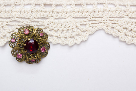 gewgaw: Vintage brooch lace on a white background