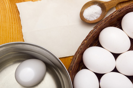 saltwort: Fresh chicken eggs in a basket on the table Stock Photo