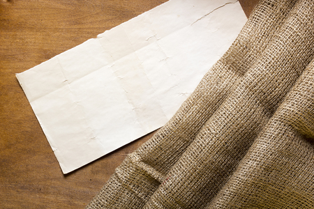 sackcloth: Sackcloth and cardboard tag on a wooden background