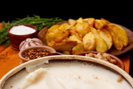 lard: Potatoes fried in lard Stock Photo