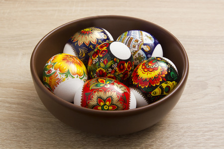 eastertime: Easter eggs in a ceramic plate on a wooden background Stock Photo