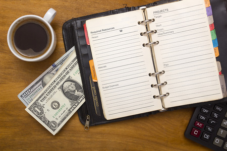 Open daily, money and cup of coffee on a wooden background Sajtókép