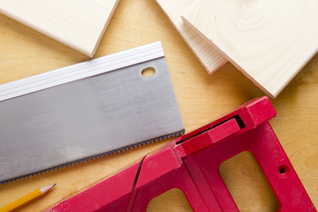 Cutting boards using the miter box and saw on the wooden background Stock fotó