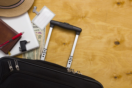 move: Suitcase decisive business traveler questions on the wooden background