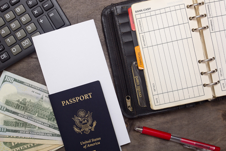Open daily, passport and money on a wooden background. Editorial