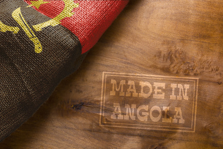 sackcloth: Made in Angola. The national flag of Angola stylized sackcloth.