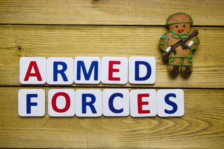 gingerbread man: Gingerbread man in a soldier on a wooden table