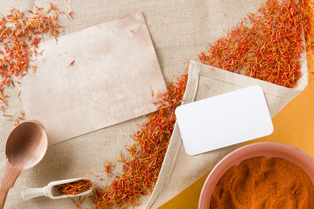 spice: Dried saffron spice on a linen napkin and ground saffron