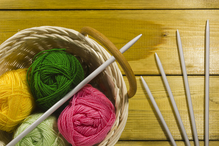 spokes: The inverted pad with the different colored threads and spokes for knitting