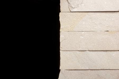 inorganic: Retaining walls of gray stone on a black background