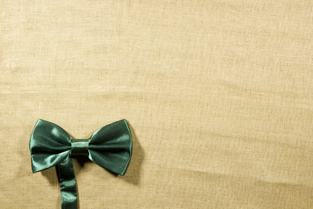 white linen: Bow tie on a background of white linen napkins
