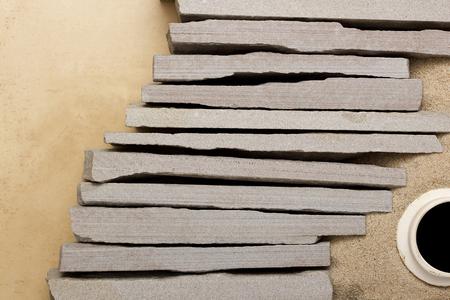 retaining: Retaining walls of gray stone and sand