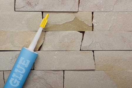 Glue in a tube for use with a stone masonry background
