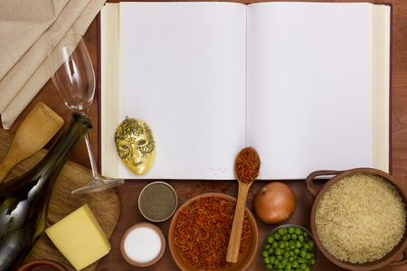 View from the top of an open book of recipes and cooking utensils