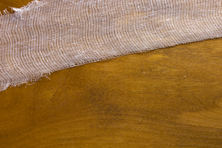 gauze: White gauze bandage on a wooden background Stock Photo