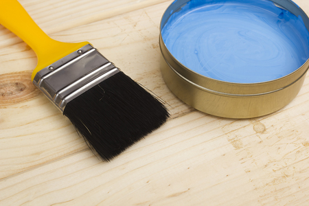 redecorate: Brush for paint and paint on a wooden background Stock Photo