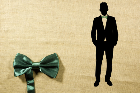 hanky: Elegant concept of using a bow-tie and a silhouette of a man