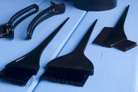 Barber Tools for hair coloring on a wooden background