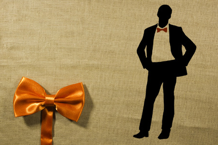 Elegant concept of using a bow-tie and a silhouette of a man