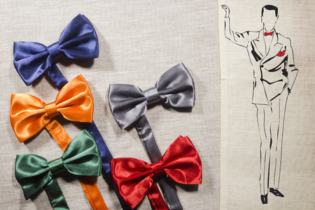 hanky: Bow ties on a gray background and the silhouette of the elegant man